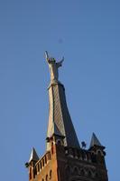 La statue du Sacré Coeur sur le sommet du clocher