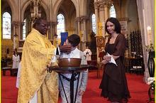Baptême d'Esteban (10 ans) en présence de sa mère Abbé I. Delouh