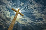 Cross against the sky. Happy Easter. Christian sym