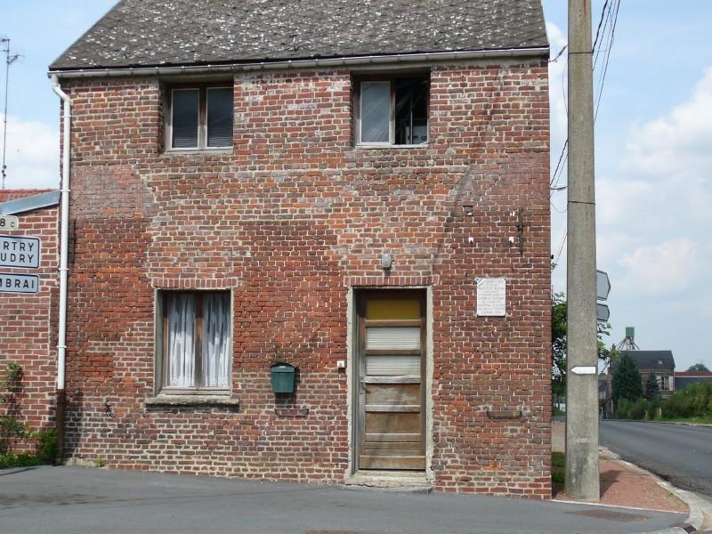 Busigny - maison plaque