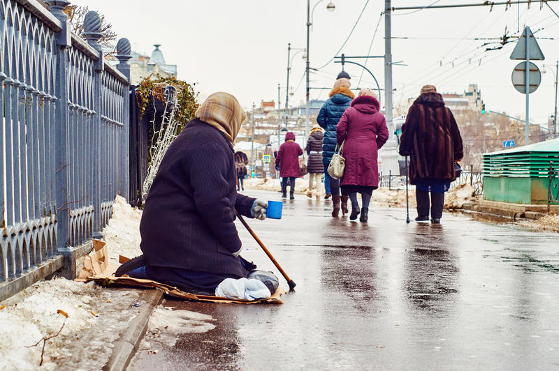 Female beggar asks for money on the Moscow street