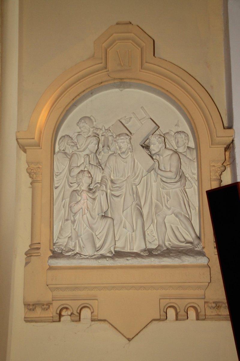 Une femme pieuse essuie le visage de Jésus